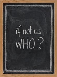 "Chalk board with message ""If not us WHO?"""