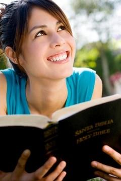 Teen girl holding Bible