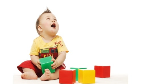 Baby Playing with colorful blocks
