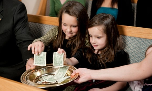 Church offering with two girls